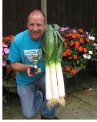 Andrew Tokely with his prize-winning leeks