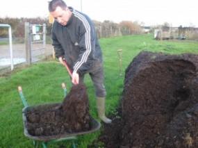 Me forking mushroom compost