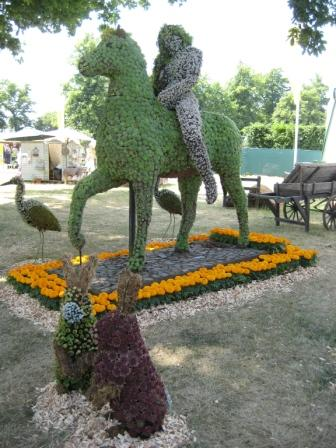 Lady Godiva on horse all in flowers